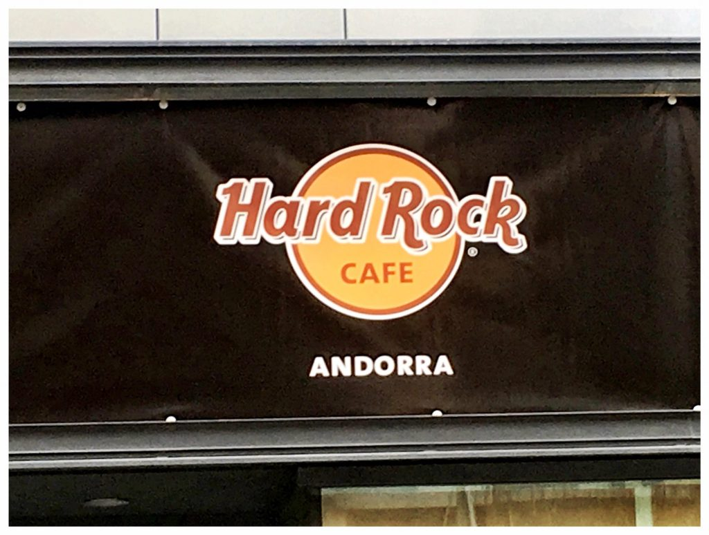 HARD ROCK CAFE ANDORRA Coming Soon A Unique Dining Experience Put down the shopping bags, rest your feet, and bite into one of our world-famous menu items such as our Original Legendary® Burger. Come for the food and stay for the experience. No matter what you're in the mood for, guests can enjoy fresh food cooked to perfection with our unique Hard Rock Cafe twist.  Breathtaking Andorra  Historic culture and stunning landscape collide in Andorra La Vella. With over 7 million tourists arriving each year, Andorra offers activities for the adventurous and luxurious alike. Shred snow at the ski slopes or indulge in duty-free shopping at one of the many boutiques and jewelers on Meritxell Avenue. Tucked within the Riu Gran Valira Valley of Andorra La Vella, Hard Rock Cafe Andorra is the perfect complement to the town's adventurous vibe.